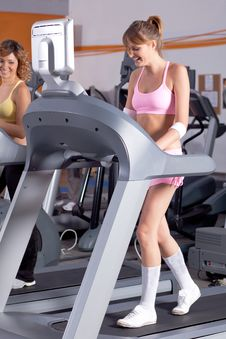 Free Woman On Running Machine In Gym Royalty Free Stock Image - 20923106