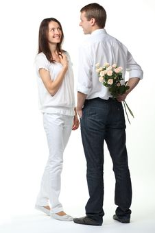 Free Guy Presenting Flowers To Young Lady Royalty Free Stock Photo - 20924255