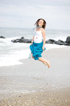 Free Beautiful Young Woman Has Fun On The Ocean Shore Royalty Free Stock Photography - 20926837