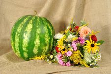 Free The Melon And Autumn Flowers Against Rough Stuff Stock Images - 20927204