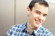 Free Handsome Man Listening To Music And Smiling Stock Photo - 20927260