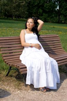 Beautiful Pregnant Girl Resting On Bench Royalty Free Stock Photos