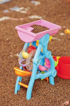 Free Toys  And   Sand Stock Photo - 20930290