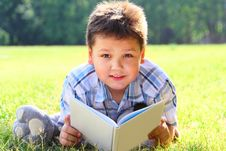 Free The Boy With The Book Stock Photo - 20933210
