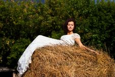 Free Brunette Woman In White Dress On Hay Stock Photos - 20933293