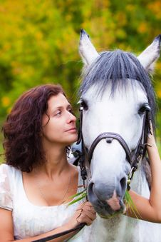 Beautiful Woman In White With A Horse Stock Image