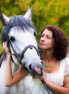 Beautiful Woman In White With A Horse Royalty Free Stock Images