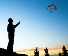 Free Young Man Isolated Flying A Rainbow Kite Stock Image - 20933771