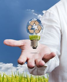 Recycle Sign In A Light Bulb With Blue Sky Royalty Free Stock Image