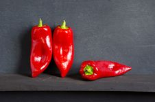 Free Three Red Peppers On Black Stock Image - 20936731