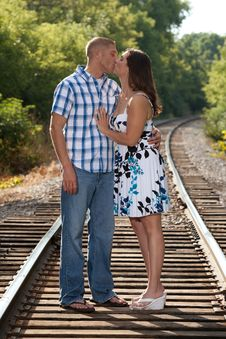 Free Couple Kissing On Tracks Royalty Free Stock Photography - 20937267