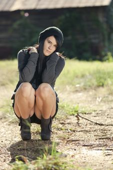 Free Beautiful Young Woman Crouching Royalty Free Stock Image - 20942956