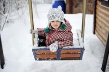 Free Adorable Child Girl Enjoys Seesaw In Winter Stock Photo - 20943950