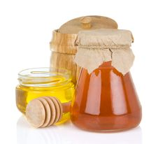 Glass Jar Full Of Honey And Stick Stock Image