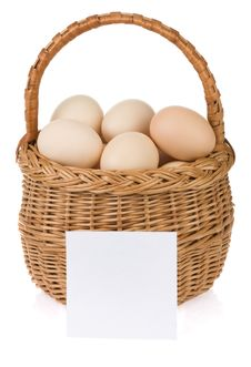 Eggs And Basket On White Stock Photo