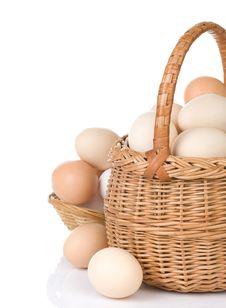 Eggs And Basket On White Royalty Free Stock Photos