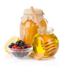 Free Glass Jar Full Of Honey And Berry Stock Photography - 20948292