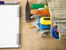 Tools And Notebook On Wood Royalty Free Stock Photo