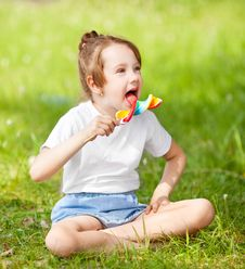 Free Girl With A Lollipop Royalty Free Stock Photos - 20948418