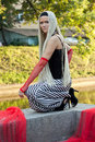 Free Young Woman With Braided Seating Near The River Stock Images - 20954514