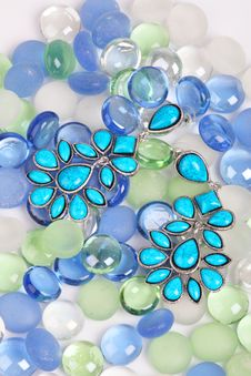 Free Earrings Against Color Pebbles Stock Photos - 20951003