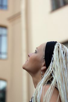 Free Young Woman With Braided Near The Building Stock Photography - 20954422