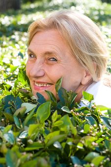 Free Old Woman On Grass Stock Photo - 20958640