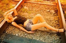 Free Beautiful Young Girl Lying On Rails Stock Photography - 20961212