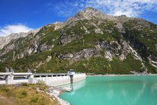 Dam Between Mountains Stock Photo