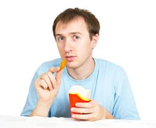 A Young Man With Fries Stock Photo