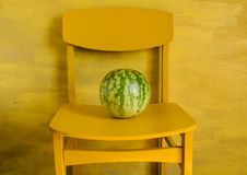 Free Watermelon On Yellow Chair Stock Image - 20963841