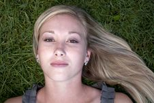 Beautiful Blond Model In Grass Royalty Free Stock Image