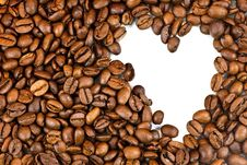 Roasted Coffee Beans And The Shape Of The Heart. Royalty Free Stock Photo