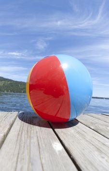 Free Colorful Beachball On A Dock Stock Images - 20966964
