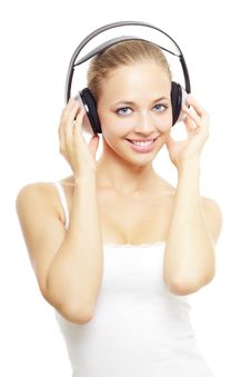 Girl Listening To Music On White Royalty Free Stock Photography