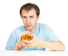 Free Man Eats French Fries Isolated Stock Photo - 20969940
