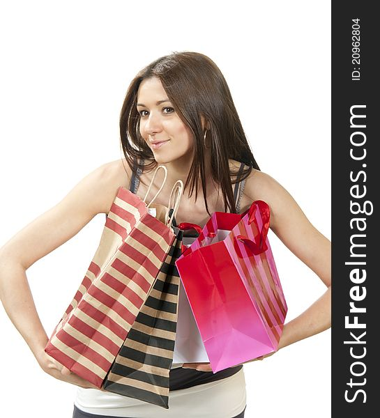 Young woman with shopping bags buying present