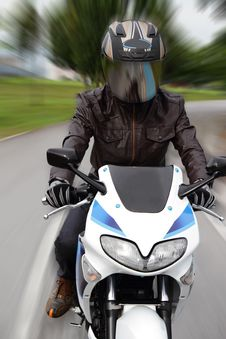 Free Speeding Motorcyclist Stock Photography - 20970262