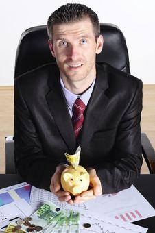 Free Man With Piggybank Royalty Free Stock Photography - 20974787