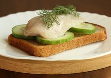 Herring On A Piece Of Rye Bread Royalty Free Stock Images