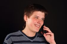 A Young Boy Talking On The Phone Royalty Free Stock Image