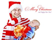 Free A Man In A Suit Holding A Christmas A Little Child Royalty Free Stock Images - 20978859