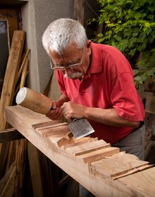 Free Woodcarver Working With Mallet And Chisel 8 Stock Images - 20980244