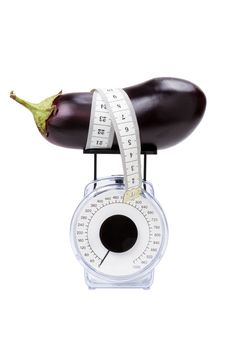 Free Eggplant With Measuring Tape On Kitchen Scale Royalty Free Stock Image - 20980436