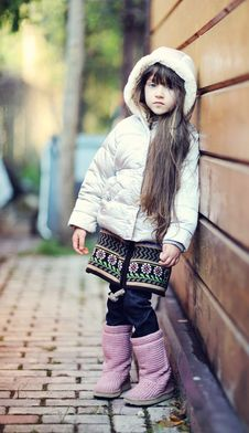 Free Cute Child Girl With Long Dark Hair Poses Outdoors Royalty Free Stock Photos - 20980828