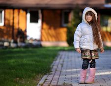 Free Cute Child Girl With Long Dark Hair Poses Outdoors Royalty Free Stock Image - 20980836
