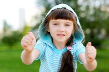 Outdoor Portrait Of Cute Child Girl In Blue Jacket Stock Image