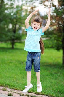 Free Happy Child Girl Is Jumping In The Air Outdoors Royalty Free Stock Photography - 20980897