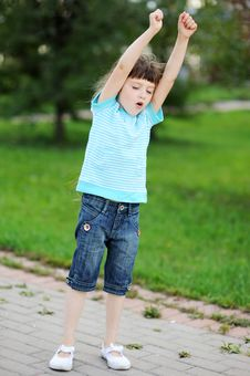 Portrait Of A Brunette Child Girl With Hands Up Royalty Free Stock Image