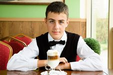 Free A Teenager Boy Enjoying Coffee In A Cafe Stock Photography - 20982362